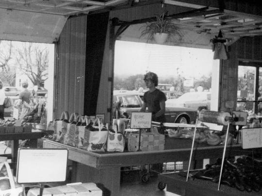 Former employee Christopher Neff works inside the market in this circa 1982 photo.