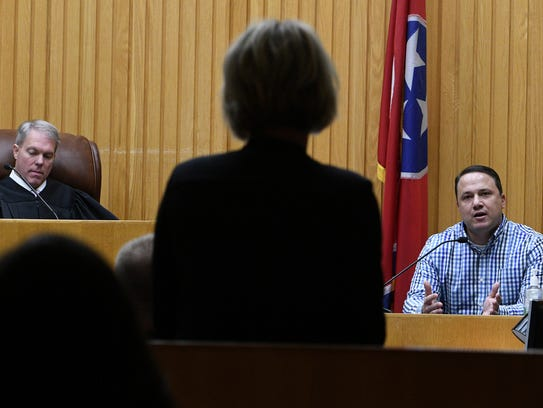 Chris Morrison testifies during the first day of testimony