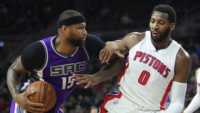 Pistons center Andre Drummond defends against Kings center DeMarcus Cousins during the second period Monday at the Palace.