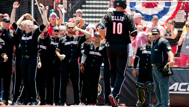 U of L's Drew Ellis scores the second of two homers in the top of the 6th inning as the Cardinals defeat the Kentucky Wildcats 6-2 in the 2017 NCAA Louisville Super-Regional. Here, Ellis crosses home plate to be met by his teammates.10 June 2017
