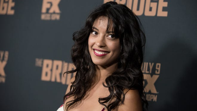 """Stephanie Sigman arrives at the Los Angeles premiere of """"The Bridge"""" in July 2014 in West Hollywood."""