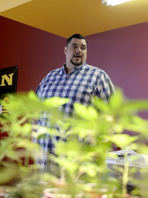 Lifelong Lansing resident Brian Hamilton, 39, is a medical marijuana dispensary owner near Old Town who supports City Council's moratorium that passed Thursday night. He owns Puff-n-Stuff at 229 W. Grand River Ave.
