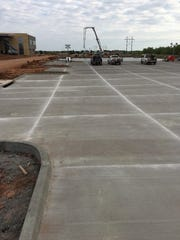 Grading and paving is continuing on the east parking
