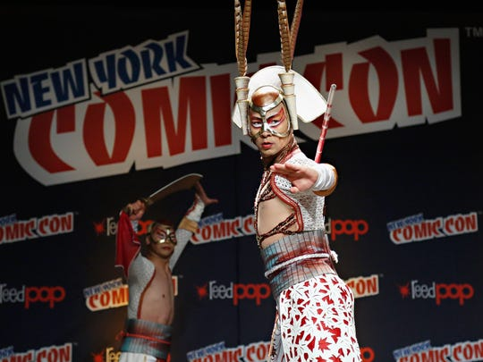 NEW YORK, NY - OCTOBER 11:  KA cast members perform as KA by Cirque du Soleil and Marvel Entertainment debut KA #3 at New York Comic-Con on October 11, 2014 in New York City.  (Photo by Cindy Ord/Getty Images for KA by Cirque du Soleil)