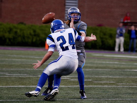 Fort Defiance's Steven Chittum attempts to sack Spotswood quarterback Alec High on Saturday, Oct. 15, 2016 at James Madison University's Bridgeforth Stadium in Harrisonburg, VA during the final game of the inaugural Shenandoah Valley High School Football Classic.