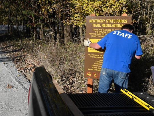 Audubon State Park employee Allen Mayo installs a sign at the Audubon wetlands trail head as Henderson County Road Department crews have constructed a entrance road and parking lot with hope the wetlands can be opened to the public as quickly as possible, November 15, 2016.