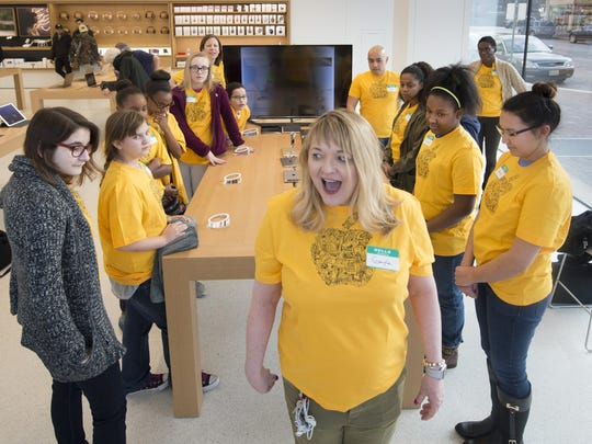 Gayle Hutchens, a creative at the Apple store on the Country Club Plaza, tries a different approach to grab the attention of members of the Kansas City Girls Who Code club while reviewing some basic principles of computer coding.
