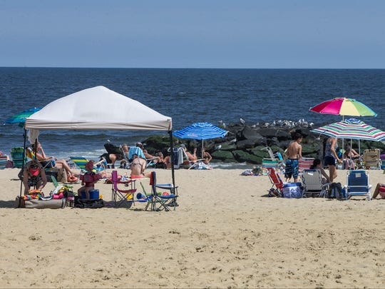 Tents and canopies set up on the beach in Belmar.