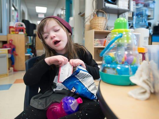 4-year-old daughter Charley Howell, spends some time in the play area while undergoing treatment at the Studer Family Children's Hospital at Sacred Heart in Pensacola on Tuesday, December 12, 2017.  Charley was recently reunited with her cat named Angel who was missing for the past 3 months.