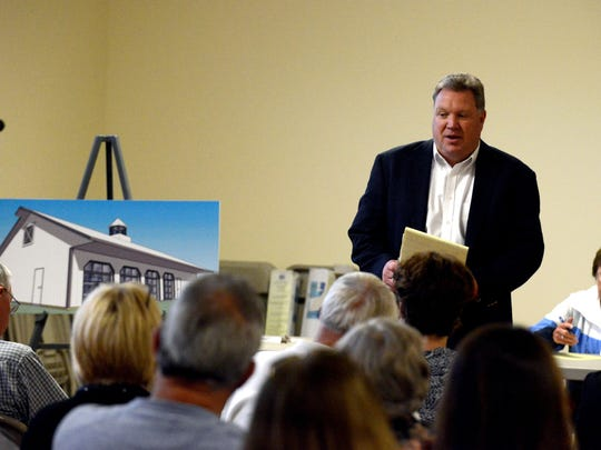Fairfield County Fair Manager Tim Voris speaks Tuesday during a meeting about what to build on the site of the old Women's Grandstand. The historic grandstand burned down last year.