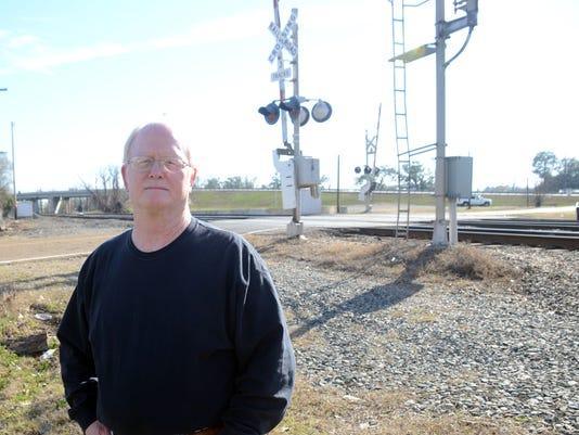 ANI Ron Kiehl at Cotton Gin Railroad Crossing Ron Kiehl says trains blow their horns at night waking the residents who live near the railroad crossing on Cotton Gin Road.-Melinda Martinez/mmartinez@thetowntalk.com The Town Talk Gannett