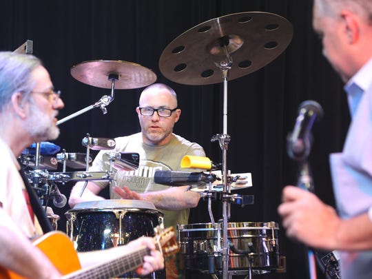 On the bongos is drummer Jarrett Zellea, a member of the Boptones from the Fair Lawn graduating Class of 1993.