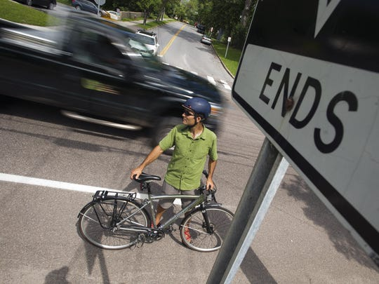 Jason Van Drieshce of Local Motion shows where the bike lane paint line ends on Pine Street, about 100 feet from the entrance to a Department of Public Works parking lot where a BED truck ran over cyclist Jason Siegel, breaking his leg.