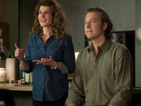 "Nia Vadaalos and John Corbett in ""My Big Fat Greek"