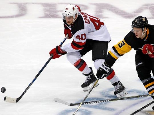 New Jersey Devils' Michael Grabner (40) controls a