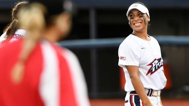 Sierra Romero smiles at her teammate during their season opening game at Space Coast Stadium.