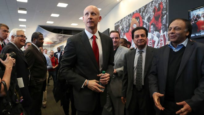Newly-hired Louisville basketball coach Chris Mack walks through a gauntlet of well-wishers at his introductory press conference at the KFC Yum! Center Wednesday afternoon, March 28, 2018.
