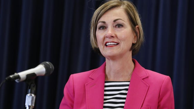 Iowa Gov. Kim Reynolds reacts Thursday as she updates the state's response to the coronavirus outbreak during a news conference at the Statehouse in Des Moines.