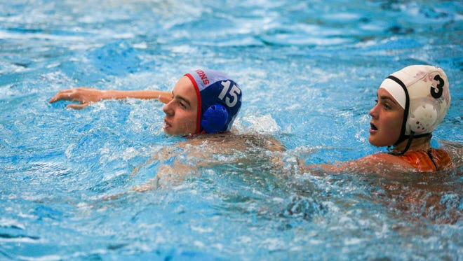South Salem's Felix von Rhein (15) goes on defense against Sprague at a water polo match up at the Ray and Joan Kroc Corps Community Center on Friday, Oct. 13, 2016.