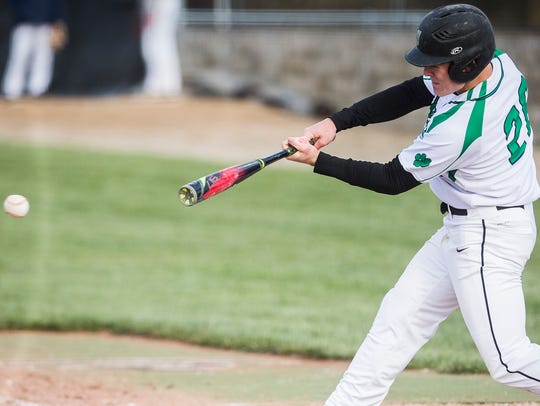 Yorktown's Grahm Reedy hits against Delta during a