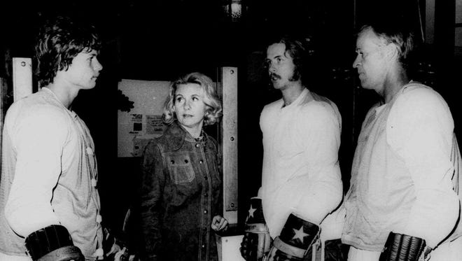 The Howes, from left: Mark, Colleen, Marty, and Gordie have a family discussion after a practice with the Houston Aeros in 1974.