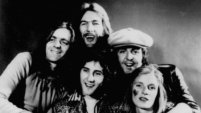 Members of the group Wings, including Paul and Linda McCartney, right, pose in this November 1972 photo. From left are Jimmy McCulloch, Denny Laine, front, Denny Seiwell, back, and Paul and Linda McCartney.
