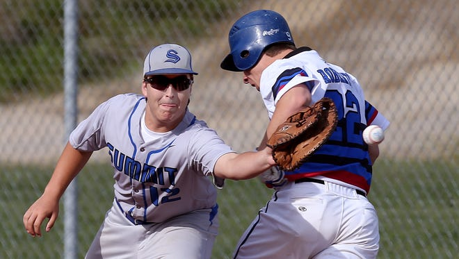 Reading's Grayson Roberts (22) beats the throw to first base against Summit Country Day's Connor McMurry (12) in the fourth inning.