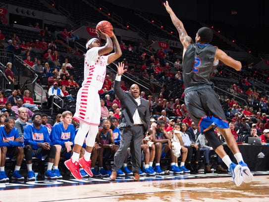 Freshman Cedric Russell, shown here attempting a 3-pointer in Tuesday's win over Louisiana College at the Cajundome, is 9-for-15 in his first two games as a Cajun.