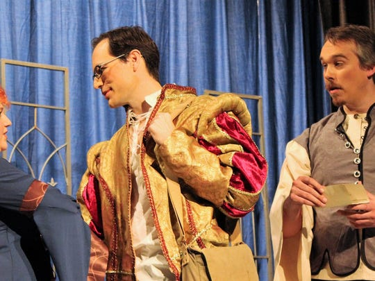 """From left: Escalus (Rose McKean), the Duke (Matt Maslanka) and the Duke's temporary successor Lord Angelo (Dana Wollschlager) after Angelo's appointment is made in this rehearsal scene from Abilene Community Theatre's """"Measure for Measure."""""""