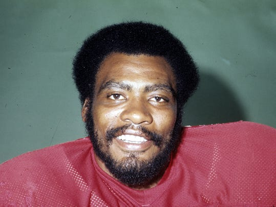 "This 1977 photo provided by the NFL shows Atlanta Falcons football player Claude Humphrey. Humphrey wishes he could have made the Pro Football Hall of Fame ""a long time ago where I could have actually enjoyed it more."" (AP Photo/NFL Photos)"