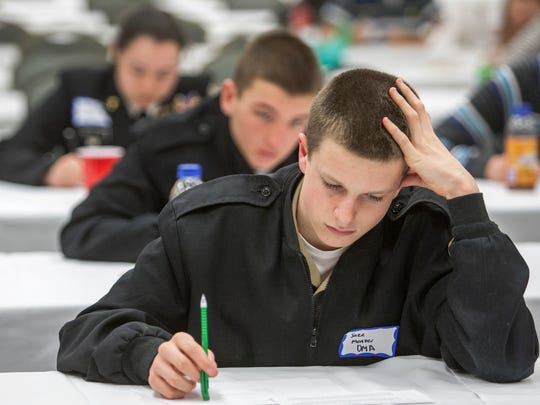 Jake Menzer, a competitor from the Delaware Military Academy, works through a math problem at the Math League High School Invitational at the Modern Maturity Center in Dover on Monday afternoon, March 31, 2014.