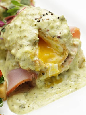 The hatch green chile hollandaise sauce over the Sierra Bonita version of eggs benedict, as seen in Phoenix on Aug. 19, 2014.