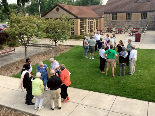 Small groups get to know each other by combining a body movement with their name at the Greater St. Cloud Area Faith Leaders annual picnic at Lake George on Sunday, Aug. 20. People from a variety of Christian and Muslim faiths participated.