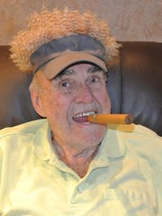 Tom Cronin gets ready for his comedy act to benefit