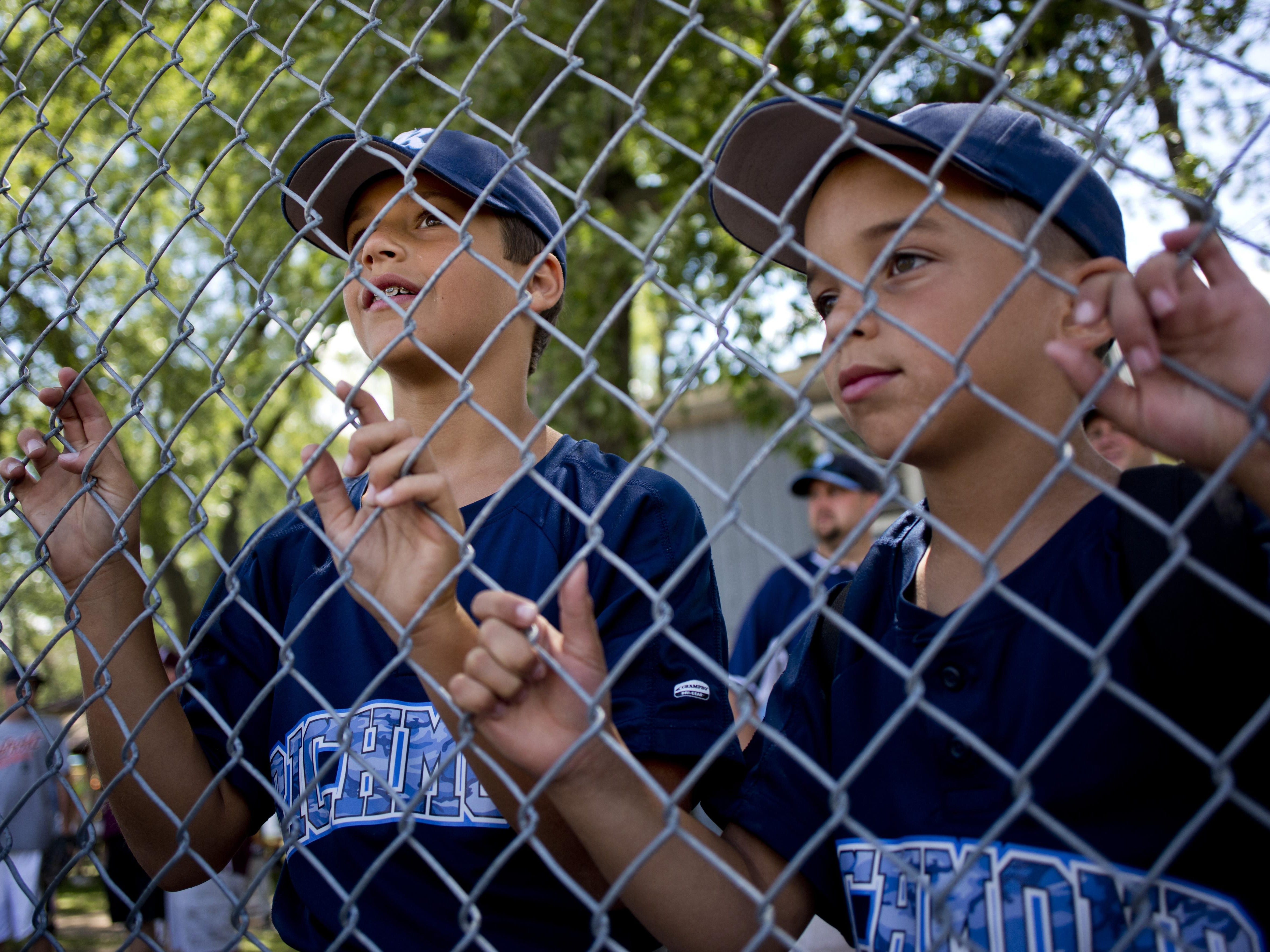 Richmond players Joey Simmons and Maximus Greenia, both 9, watch from behind the fence during a Little League skills competition Saturday, August 1, 2015 at Marysville City Park.