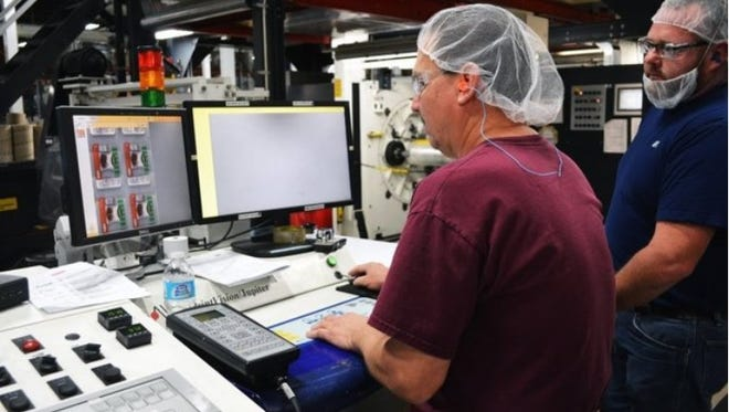 In this 2016 file photo. Doug McCaffery, sitting, and Bryan Roderick, press and laminating operators at Sealed Air (Cryovac), make sure shrink wrap for Jennie-O ground turkey is ready for production at the Wichita Falls plant. The Wichita Falls City Council is considering approval of a $1.25 million forgivable loan May 1 for improvements at their two plants.