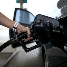 PEMBROKE PINES, FL - NOVEMBER 15:  Melissa Cassidy pumps gas into her car from a pump with a sign indicating the gas is containing up to 10 % ethanol  at Victory gas station on November 15, 2013 in Pembroke Pines, Florida. Today, the federal Environmental Protection Agency announced a proposal to ease an annual requirement for ethanol in gasoline.  (Photo by Joe Raedle/Getty Images)
