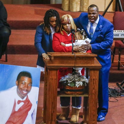 Antonio LeGrier, right, father of Quintonio LeGrier, stands with family as he eulogies his son during funeral services at New Mount Pilgrim Missionary Baptist Church in Chicago on Jan. 9, 2016.