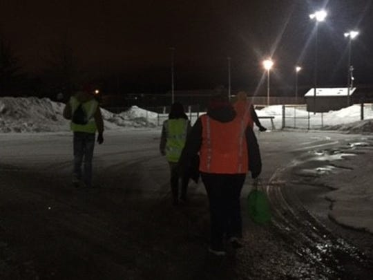 Volunteers don reflective vests as they begin to search for those experiencing homelessness in Marathon Park during the night hours of Jan. 25, 2017. The volunteers were a part of the Point in Time count, which aims to identify how many people are experiencing homelessness in the Wausau area.