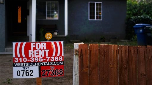 This Friday, Feb. 27, 2015, photo shows a sign advertising a house for rent in Los Angeles. More than one-in-four renters must devote at least half of their family income to housing and utilities, according to a new analysis of Census data by Enterprise Community Partners, a nonprofit that helps finance affordable housing.  (AP Photo/Richard Vogel)