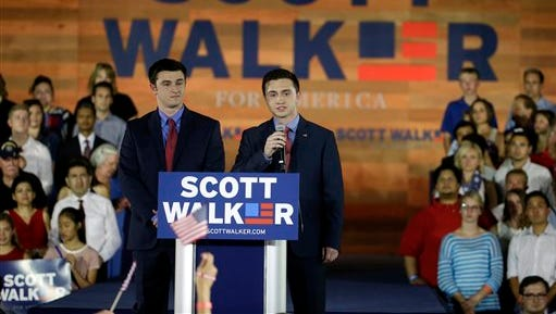 Wisconsin Gov. Scott Walker's sons Alex, left, and Matt speak to supporters before their father announces he is running for the 2016 Republican presidential nomination at the Waukesha County Expo Center, Monday, July 13, 2015, in Waukesha.