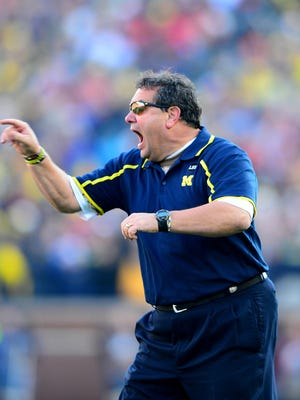 Michigan Wolverines head coach Brady Hoke gestures on the sidelines during the fourth quarter against the Ohio State Buckeyes at Michigan Stadium.