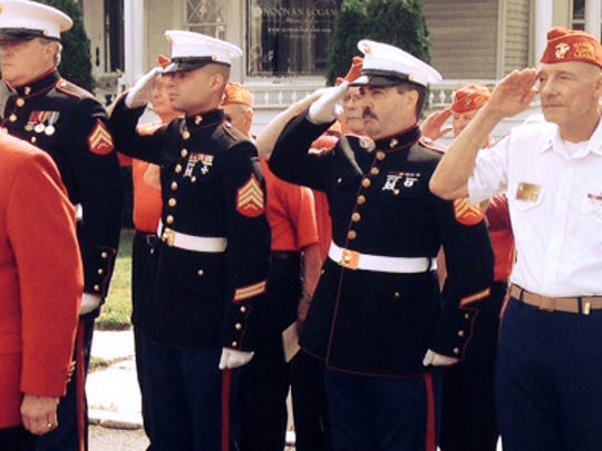 Members of the Veterans of Foreign Wars salute the installation of a new World War II monument in Freehold.