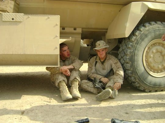 Pvt. Kythe Yund, right, a 20-year-old Marine, sits in the shade of a military vehicle during a deployment to Iraq in 2009. Yund is one of 15 Marines who have killed themselves while at the Twentynine Palms Marine base since 2007.