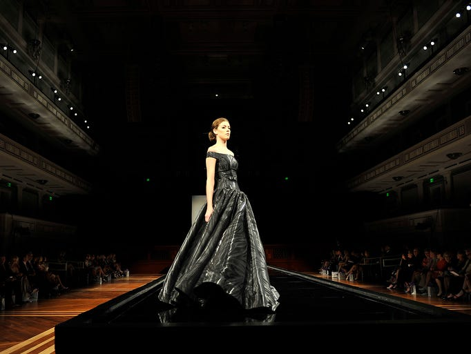 A model walks the runway during the Symphony Fashion Show at Schermerhorn Symphony Center on Tuesday, April 29, 2014.