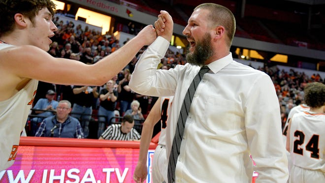 Roanoke-Benson head coach Abe Zeller fist-bumps his players after their 45-43 victory over Chicago Fenger in a Class 1A supersectional Tuesday, March 10, 2020 at Redbird Arena in Normal.
