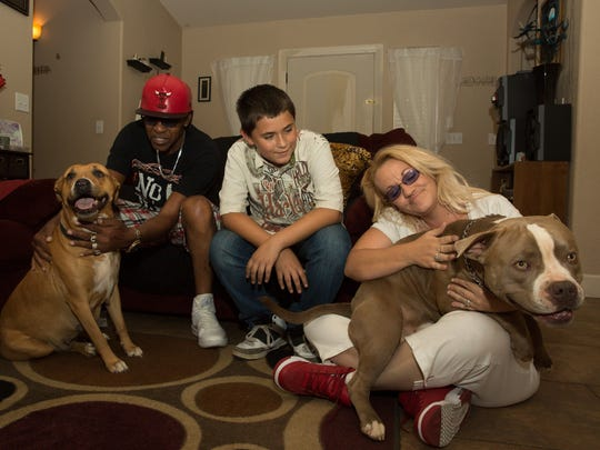 Tom Brown, left, Jaccob Diaz, 13, and Charlotte Brown pet their dogs Mamas, left, and Boss, the parents of Tigger on Friday, September 16, 2016. Nine month old Tigger was to be in quarantine after biting Diaz's friend on September 3, 2016 but was euthanized by Animal Service Center of the Mesilla Valley on September 12, 2016.
