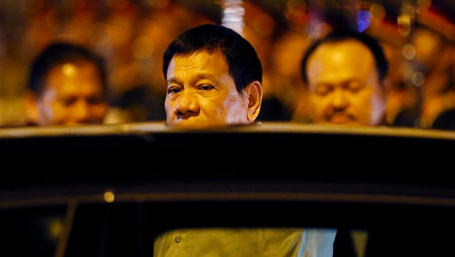 Philippine President Rodrigo Duterte boards his limousine upon arrival in Vientiane, Laos to attend the 28th and 29th ASEAN Summits and other related summits Monday, Sept. 5, 2016 in Vientiane, Laos. Laos is this year's host of the annual regional meeting and its dialogue partners that includes the United States, Canada, Russia, Japan, China, South Korea, Australia, New Zealand and India.