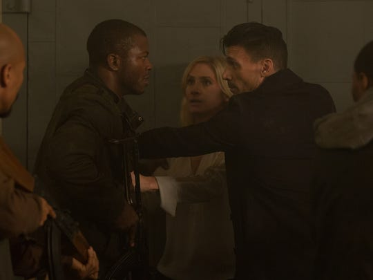 Edwin Hodge (from left), Elizabeth Mitchell and Frank