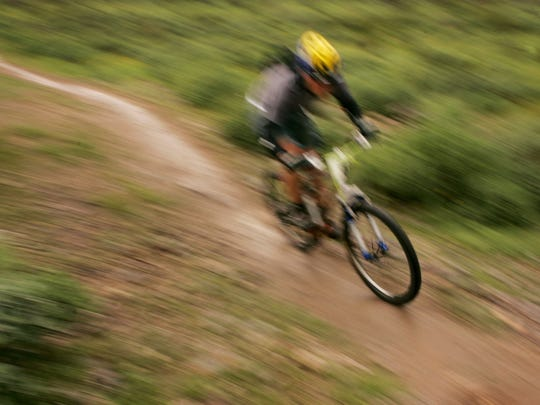 Competitors are a blur of color as the take part in the Estrella Especial at Estrella Mountain Regional Park Competitive Track.